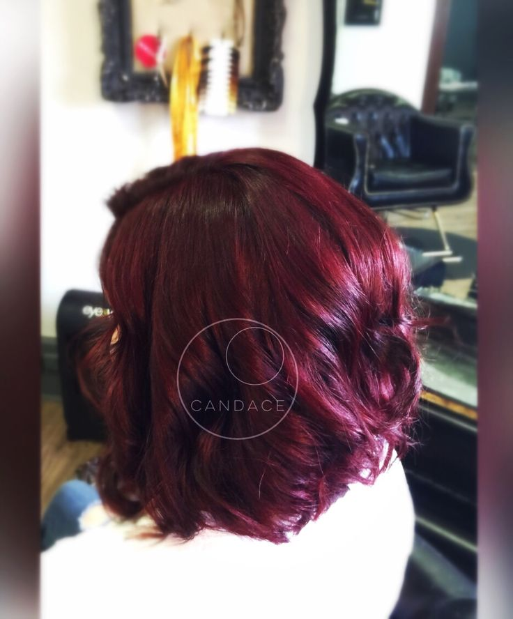 Vibrant red violet hair color.