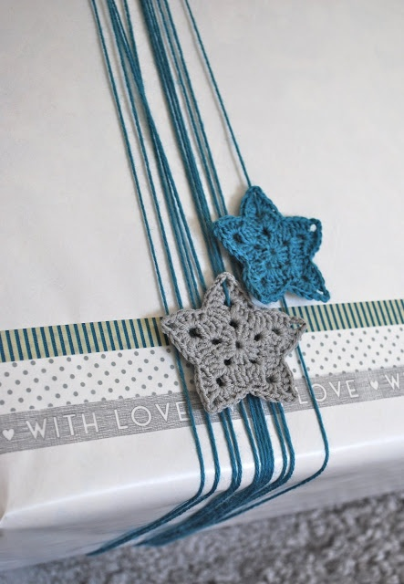 Washi tape, crocheted stars decorating a gift
