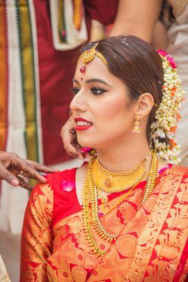 South Indian Brides - Sanjana & Sanjeev | WedMeGood | Red Kanjeevaram Silk Saree with Gold Choker and Long Necklace, Gajra in Hair  #wedmegood #indianbride #indianwedding #southindianbride #bridal #gold #jewelry #silksaree #kanjeevaram