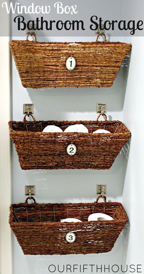 Bathroom  Tip:  Use window baskets hung on the wall to corral extra toilet paper, beauty supplies and towels. {Even works over the
