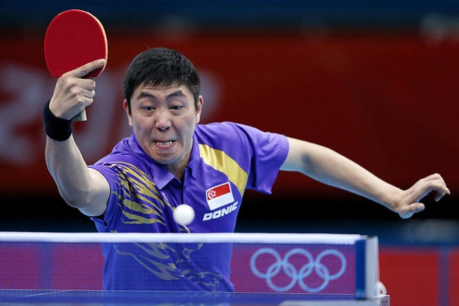 Ning Gao of Singapore returns the ball during his Men's Singles Table Tennis match. Need his shirt for LSU games.