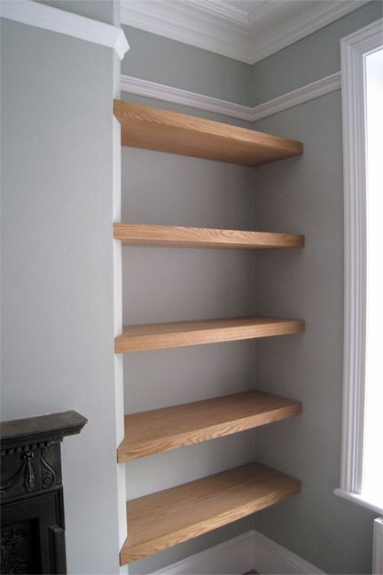 Floating shelves which slightly wrap onto the wall, would look nice next to our fireplace.