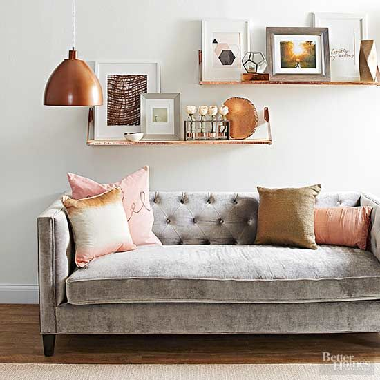 This living room promotes its friendly gray and blush tones with warm copper accents. Metallic paint, string, and fabric add perfect details. The shelves are fronted with copper foil electricians tape, available at most hardware stores.