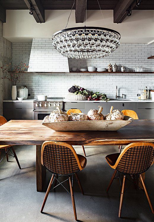 We're wild for the understated cool of this open grey kitchen, from the polished concrete floor to the hand-blown glass chandelier.
