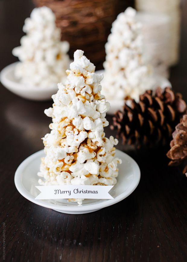 How to make Popcorn Christmas Tree Place Cards DIY. These place cards do double duty as an edible treat!