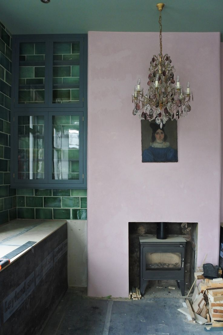 pink and green walls, old school handmade green metro tiles and a big antique chandelier