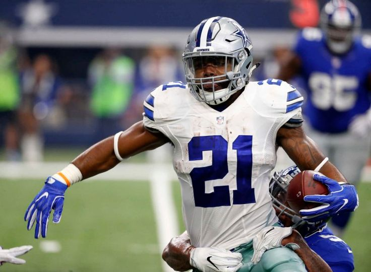 Dallas Cowboys running back Ezekiel Elliott (21) fights for extra yardage as New York Giants outside linebacker Jonathan Casillas attempts the stop in the first half of an NFL football game, Sunday Sept. 11, 2016, in Arlington, Texas.
