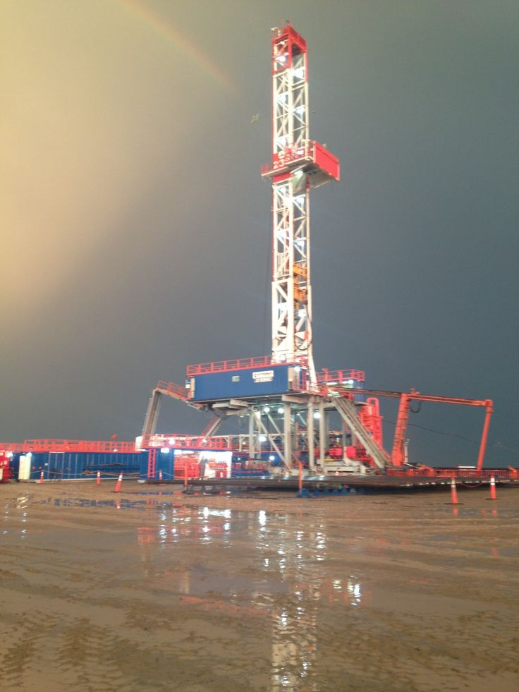 Oil rig with a rainbow behind it