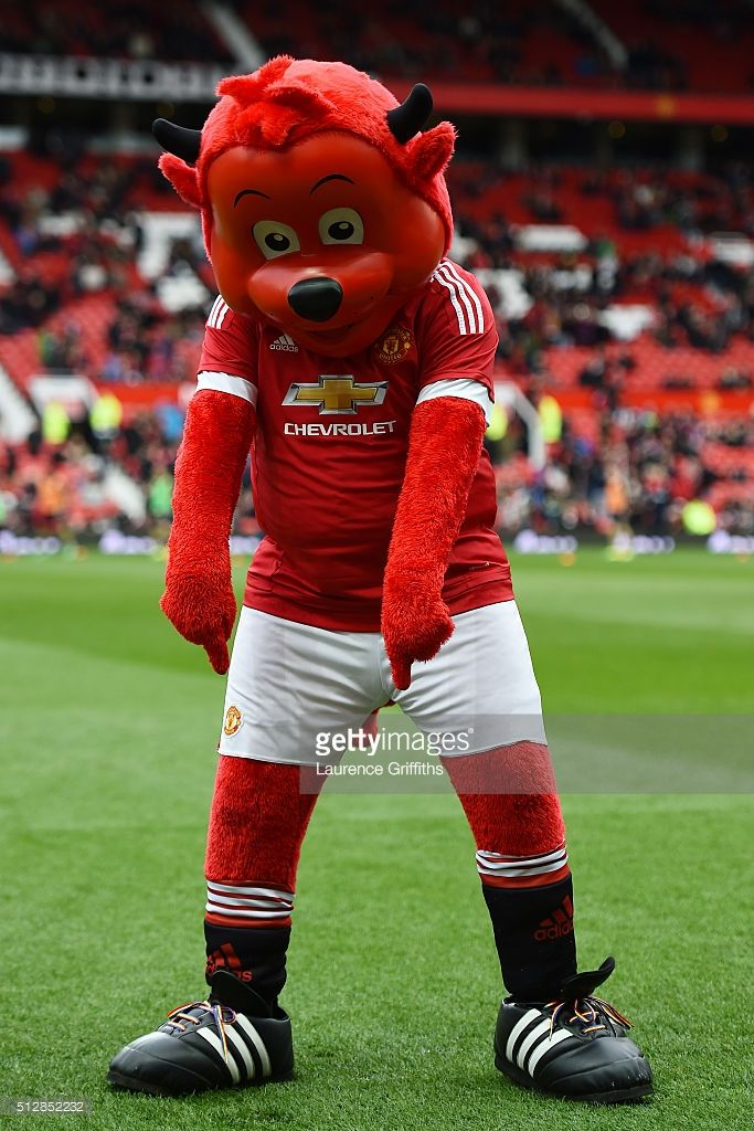 Manchester United mascot Fred the Red points at his rainbow laces during the Barclays Premier League match between Manchester United and Arsenal at Old Trafford on February 28, 2016 in Manchester, England.