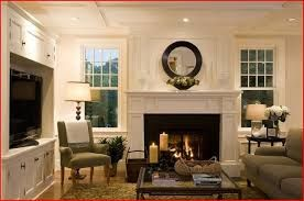 Image result for fireplace between windows