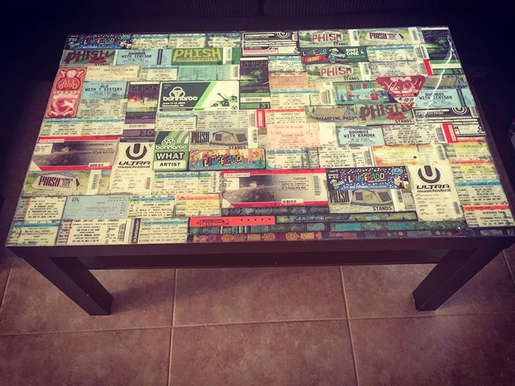 Hello! I am sharing a tutorial on how to cover a table with your favorite  collected mementos with polyurethane. I used all the concert tickets and  wristbands my husband and I have been saving for years to cover our basic  Ikea coffee table.  Ticket stubs are now a thing of the past, as so many of  our recent shows have been a home printer ticket or an electronic version.  Our music memories are now sealed under the polyurethane, resembling a  glass top. The tickets look great and we no…