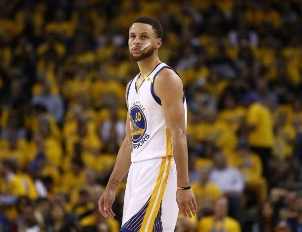 Stephen Curry of the Golden State Warriors looks on against the Utah Jazz during Game Two of the NBA Western Conference SemiFinals at ORACLE Arena on...
