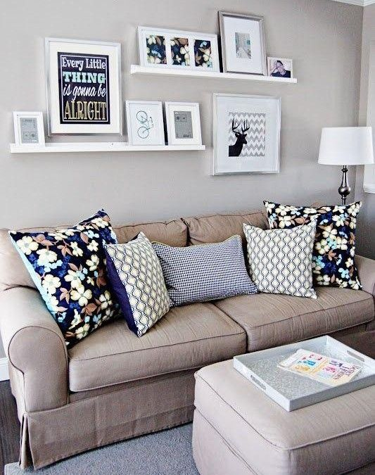 Cute picture arrangement for above couch.
