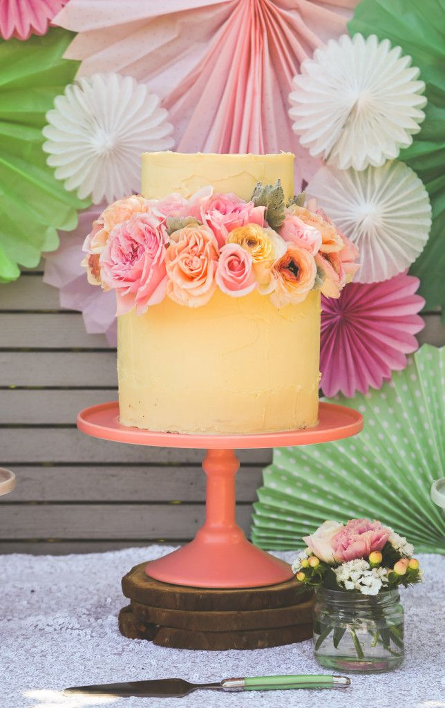A Blooming Brilliant Wedding in Terrigal Styled by the Blooming Brilliant Floristry and Events Team including ranunculus, floral cake topper, macarons, sweet table, rose lollipops, roses, stattince, magnolia, lisianthus.