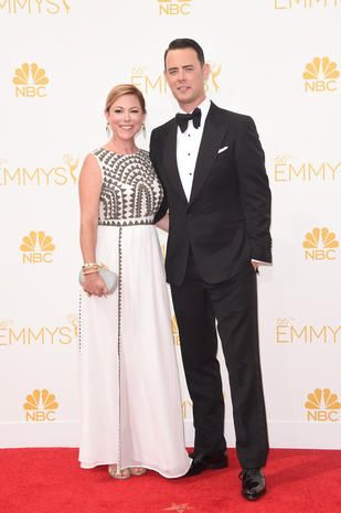Actor Colin Hanks, right, and Samantha Bryant attend the 66th annual Primetime Emmy Awards held at Nokia Theatre L.A. Live in Los Angeles, Aug. 25, 2014.