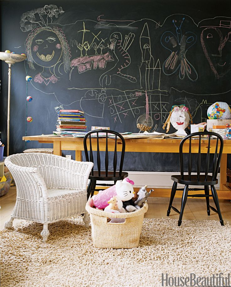 """In Ruby Beets's East Hampton house, Benjamin Moore's blackboard paint covers her daughters' playroom walls, ready when inspiration strikes. The black Farmhouse chairs are from Pottery Barn Kids and the worktable is from Ikea, its legs cut down to child-size. """"When the girls have their friends over, they're not far away, but they can do their own thing without being too with us,"""" she says. """"They have their table where they can draw, and a little sofa. They can draw on the wall because it's…"""