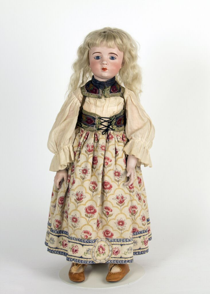 A. Marque Doll in Alsace Costume, 1916.  All Marque dolls were dressed by Margaine-Lacroix to keep her staff employed during the First World War. The costumes represented royal and historical figures from France's past and regional attire from France's provinces. The A. Marque in the collections of the National Museum of Play wears an outfit of the Alsace region.