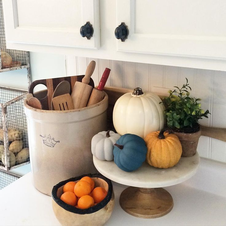 Fall kitchen - love the old crock filled with rolling pins and the pumpkins on a cake stand eclecticallyvintage.com