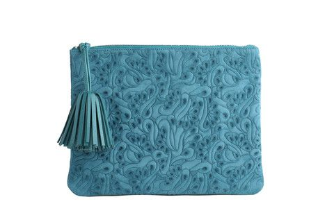 Editors Pouch Flower Party in teal. Executed in a monochromatic graphic floral, this pouch plays well with other prints.  Sling it crossbody, or tuck this versatile bag under your arm like a clutch.