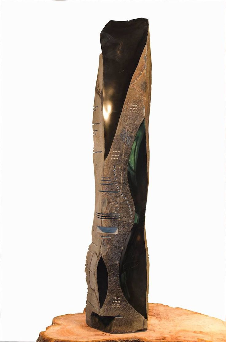Basalt stone column carved by Daniel Poisson of Pitch and Trace Industries in Victoria BC Canada.