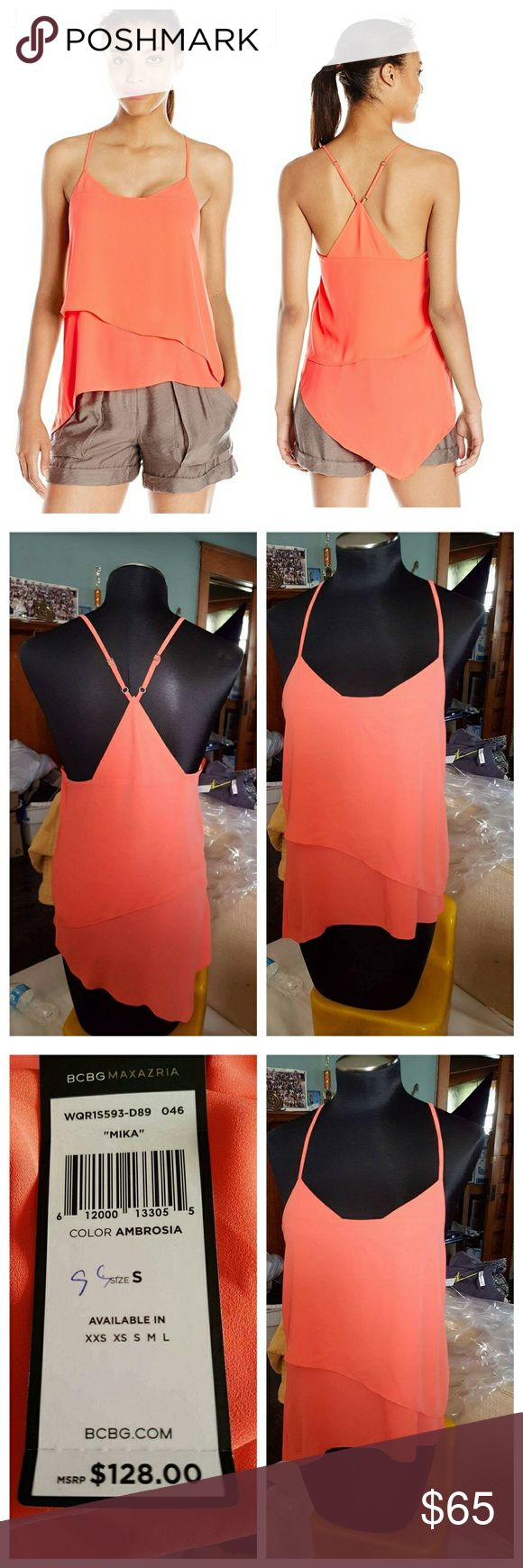 🎉New Bcbg Maxazria Mika Relaxed Tank Embrace the warmth of the season in a relaxed tank with high-contrast color blocking, adjustable crisscross straps and asymmetrical hemline.  100% Polyester Machine Wash PulloverV-neck, sleeveless with adjustable straps. Open back with multi-strap detail Asymmetrical hemline   NEW WITH TAGS  Size Small  COLOR Ambrosia BCBGMaxAzria Tops Tank Tops