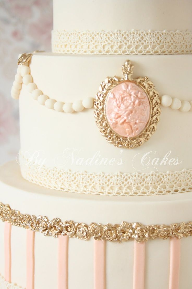 Marie Antoinette shabbychic wedding cake -  I love this cake...reminds me of mine...except my cameos were made of white chocolate . Cake was cream color with peach trim and cameos hanging from the trim.  This one is really elegant