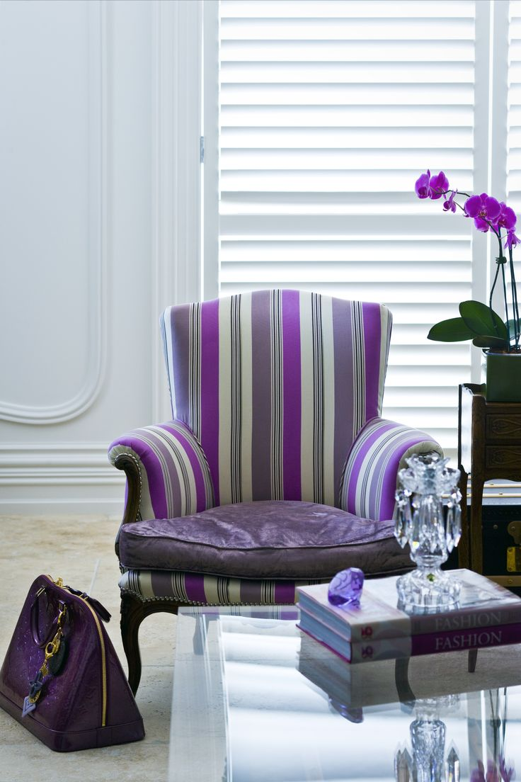 Upholstered chair with Louis Vuitton bag to match