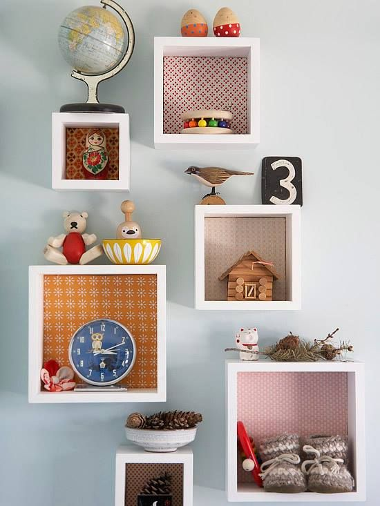 Out Of The Box On A Wall In The Bedroom Wooden Cubbies Are Hung For Displaying Knickknack Items Colorful Fabric Swatches Used As Backing Make Bright