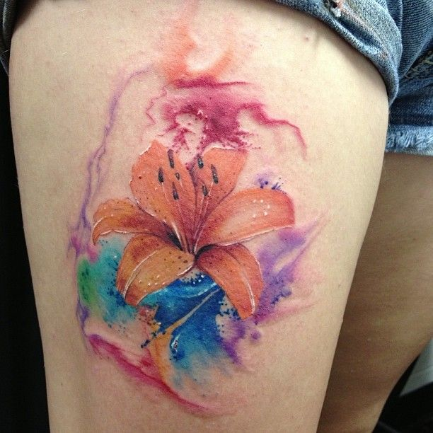 Watercolor style tiger lily tattoo.