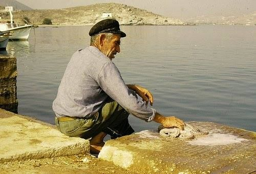 A shot of a simple man collecting octopus & other sea life to sell at the fish market. #Paros #Greece #Beautiful #Old #Vintage #Vacation #Ocean #Summer #Octopus #Sea #Greek