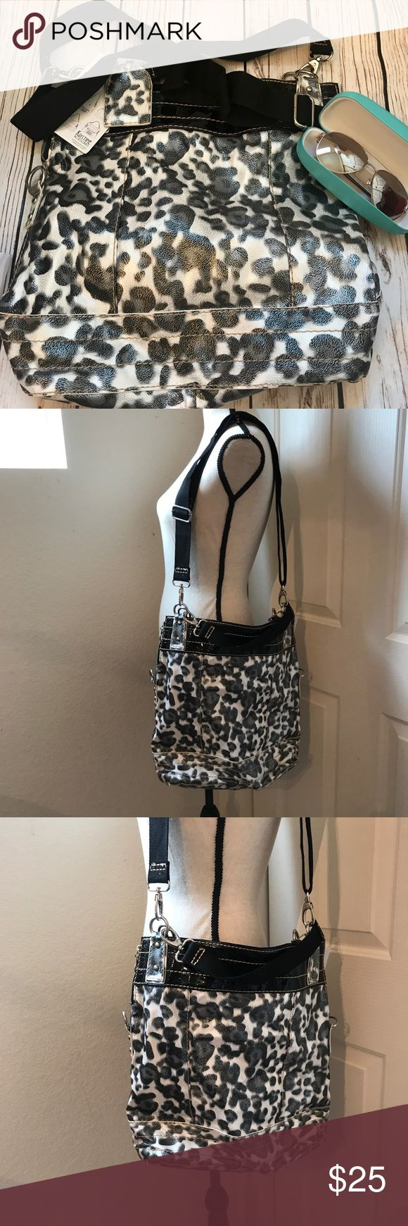 "Animal Print Tote Bag New Black & White Women's 8️⃣ 08/25/17 ⭐️️New with tags  ⭐️️adjustable long strap short strap magnetic closure ⭐️️soft velvet like interior with one small pocket  ⭐️can adjust to create several different looks  ⭐️Approx measurements laying flat: Length 14"" width 15"" Base 6"" Wide 🚫trades, holds or modeling please Bags Totes"