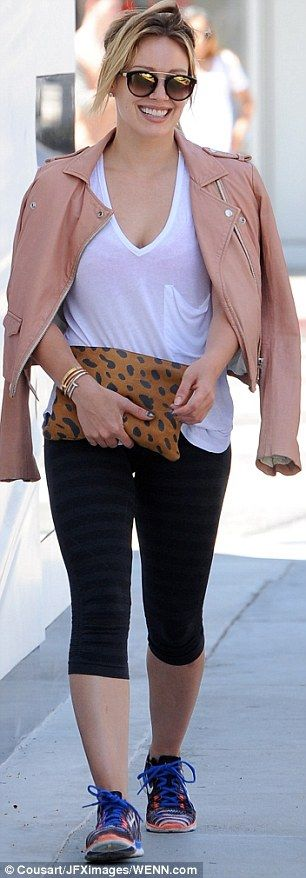 Stylish: The singer dressed up her look with a pink leather jacket slung casually over her...