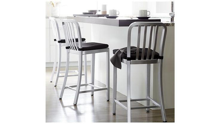 Shop Delta Bar Stools and Cushion.   Crafted of machine-cut anodized aluminum, each sturdy yet lightweight stool is welded together and hand polished to a soft sheen.  The contoured back and molded seat ensure a comfortable sit.