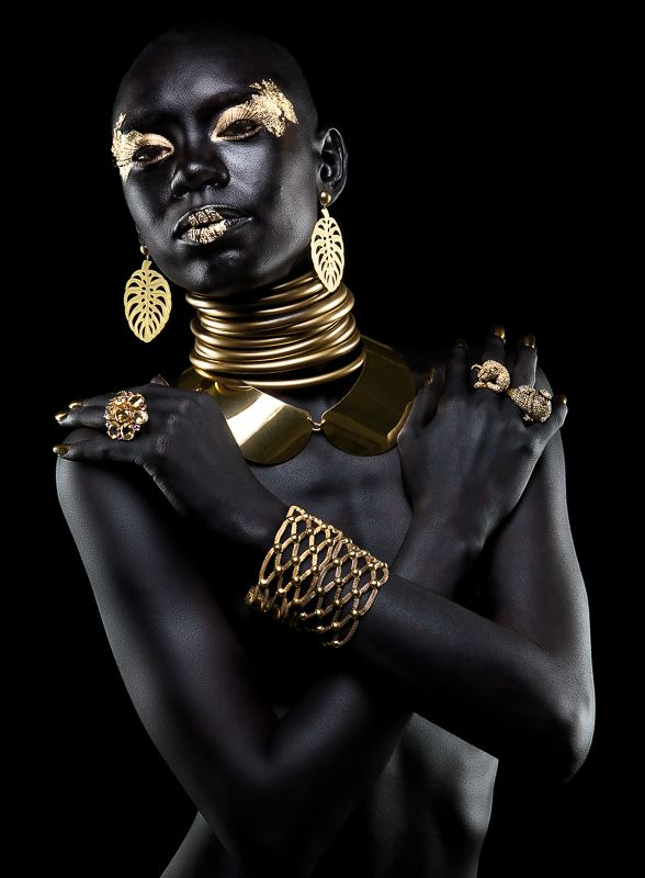 "This type of photography is maybe in a category of its own, or I guess would fall into the ""fashion"" category. I think the black on black with gold accents is stunning. An extremely beautiful portrait that really grabs your attention."