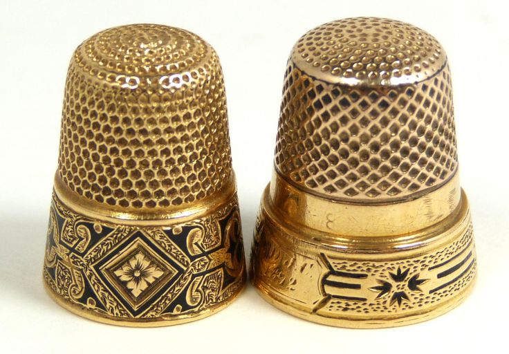 """PAIR OF ANTIQUE 22KT YELLOW GOLD THIMBLES  One has etched and black enamel floral border with a monogram of """"Louise"""". The next has an etched floral black enamel border design and has a monogram of """"MIJC 1872""""."""