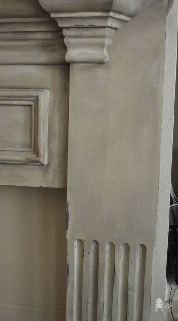 I changed the look by using chalk paint fireplace mantel using Annie Sloan's Chalk Paint in Country Grey, Old White, and French Linen.