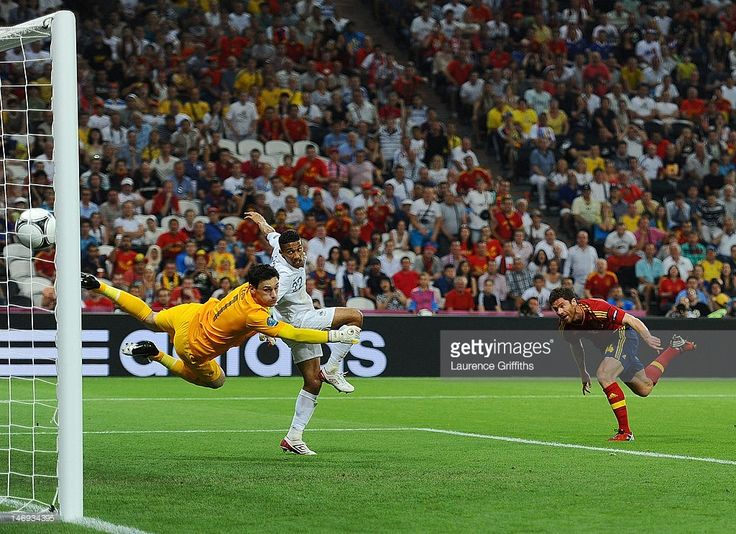 Xabi Alonso of Spain scores the first goal past Hugo Lloris of France during the UEFA EURO 2012 quarter final match between Spain and France at Donbass Arena on June 23, 2012 in Donetsk, Ukraine.