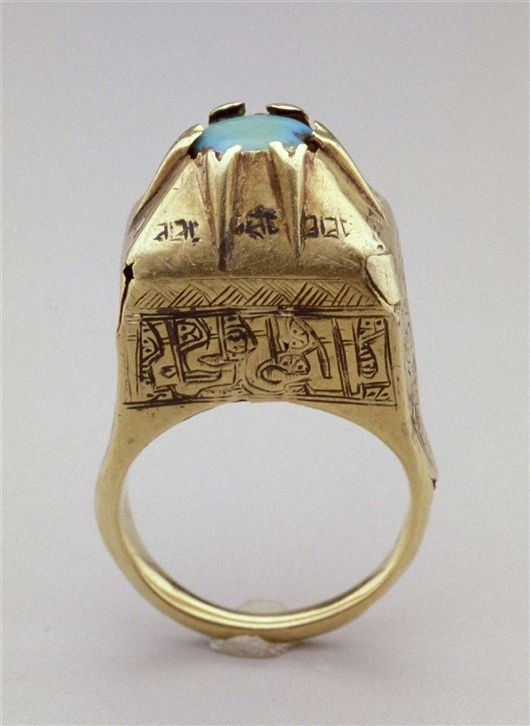 Ring (inscriptions means Blessing). Gold, turquoise and black compound. 1100's AD Iranian.