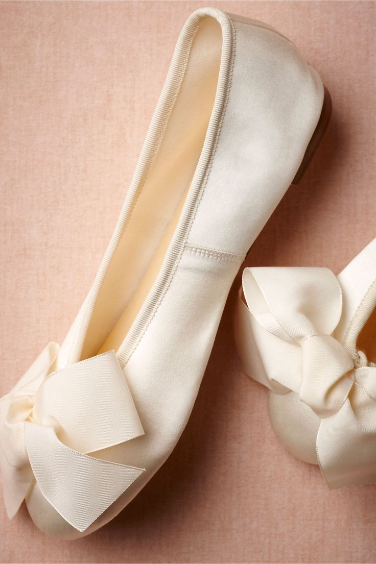Satin Ballet Flats    Skip a heel and opt for the classic styling of Soir de Lune's satin ballerinas, topped off with an oversized satin bow. By Soir de Lune. Satin upper with leather sole. Handmade in France.