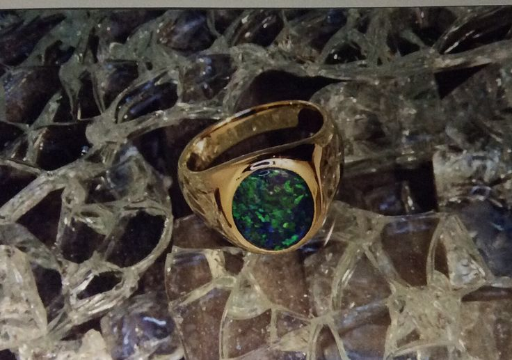 opal triplet set in yellow gold signet ring