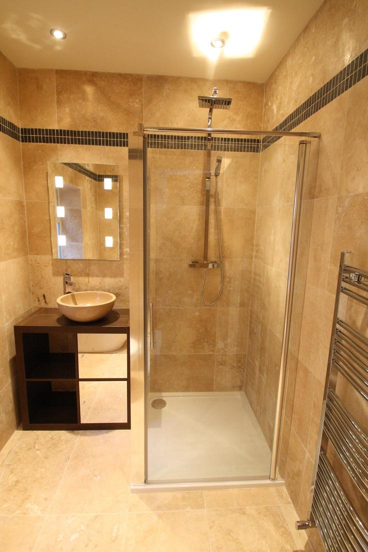 Travertine and Slate en-suite bathroom, Birmingham. Can you spot the innovative use of an Ikea EXPEDIT bookshelf?