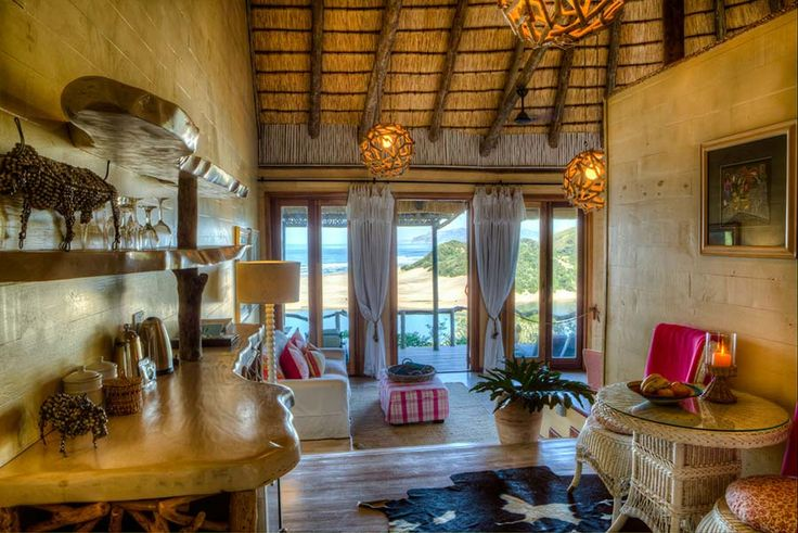 NTABENI: DELUXE SPA SUITES. Adults Only. You'll discover that our recent additions nestled on the hillside near the spa, the tastefully decorated, spacious Ntabeni spa suites are just what the doctor ordered. These suites offer 180 degree views of the ocean in luxurious comfort, with a rejuvenating experience for you mind and body close at hand. Umngazi River Bungalows and Spa - Award-winning family resort and spa - Wild Coast, Eastern Cape, South Africa.