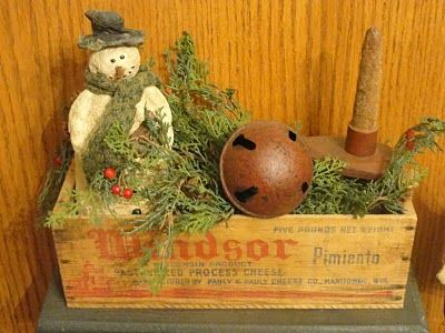 Old Cheese Box...grungy snowman, candle, greenery & rusty jingle bell...~ I have all the above.. Think I will do this..