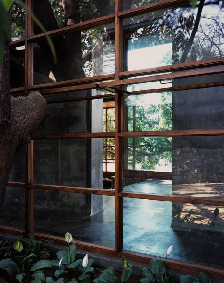 casement windows which slide up to top side of window. NICE    Belavali House / Studio Mumbai