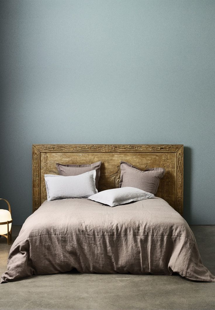 Use a carved headboard in your bedroom for a more traditional and elegant look.