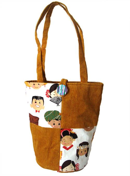 World of Children Round Tote handbag corduroy AUD59.00 This is an tote with round base made up of imported cotton fabric and cordroy material. Fully lined with padded wadding. Inside there are 3 pockets for your mobile and small stuffs.   Dimensions:  - Base: Diameter about 19cm - Height (excluding strap) 24cm - Strap 22 cm from the centre http://www.imusthavethat.com.au/pd-world-of-children-round-tote.cfm