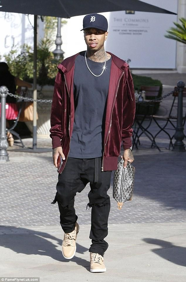 Tyga wearing Daniel Patrick x T-Raww Ripped Skinny Jeans in Black and Goyard Chevron Boeing 25 Trousse De Toilette