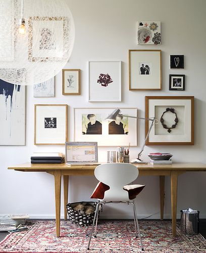 We're in LOVE with this wall grouping. There's a totally unique mix of art and objects, but everything is kept relatively neutral. It's a great example of incorporating custom framed objects into gallery walls. And take a cue from the horizon line method used to hang - the bottom row is all hung at the same level, allowing the pieces above to fit in more randomly. Stunning!