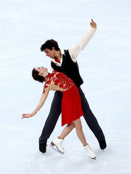Alexandra Paul and Mitchell Islam of Canada compete in the Figure Skating Ice Dance Free Dance on Day 10 of the Sochi 2014 Winter Olympics a...