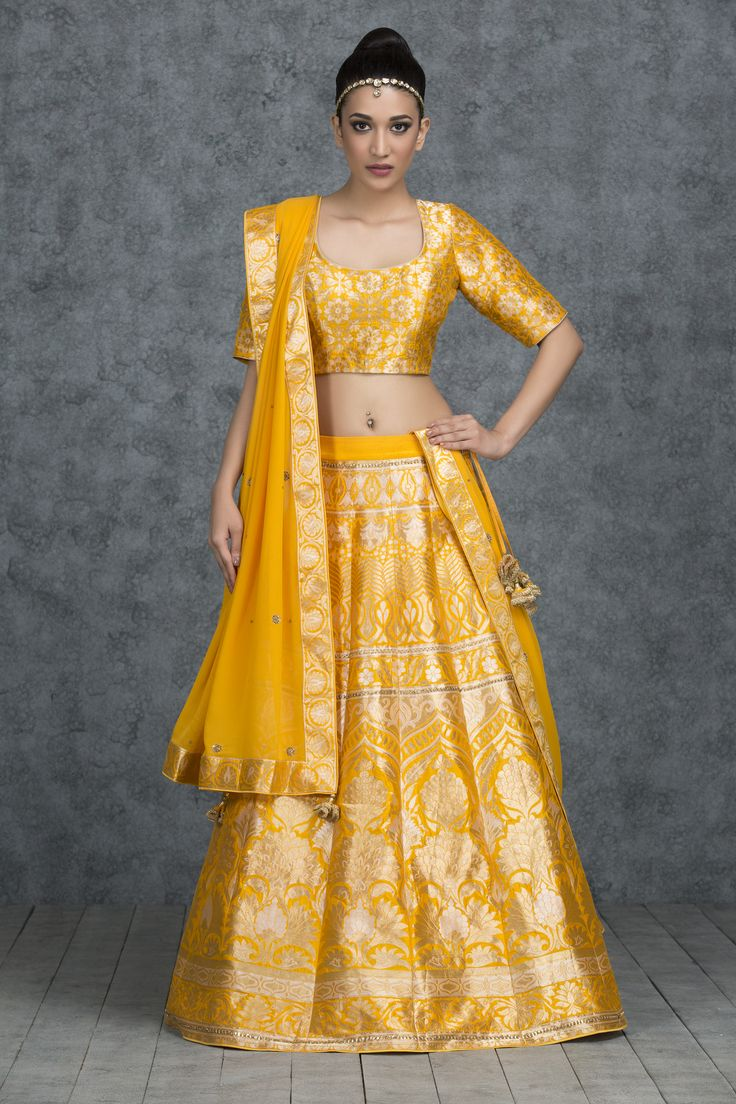 Steeped in the magnificence of traditional bridal couture, this marigold banarasi silk bridal lehenga enhances the bridal look. Paired with a matching marigold banarasi silk long sleeve choli and georgette dupatta completes the bridal look.
